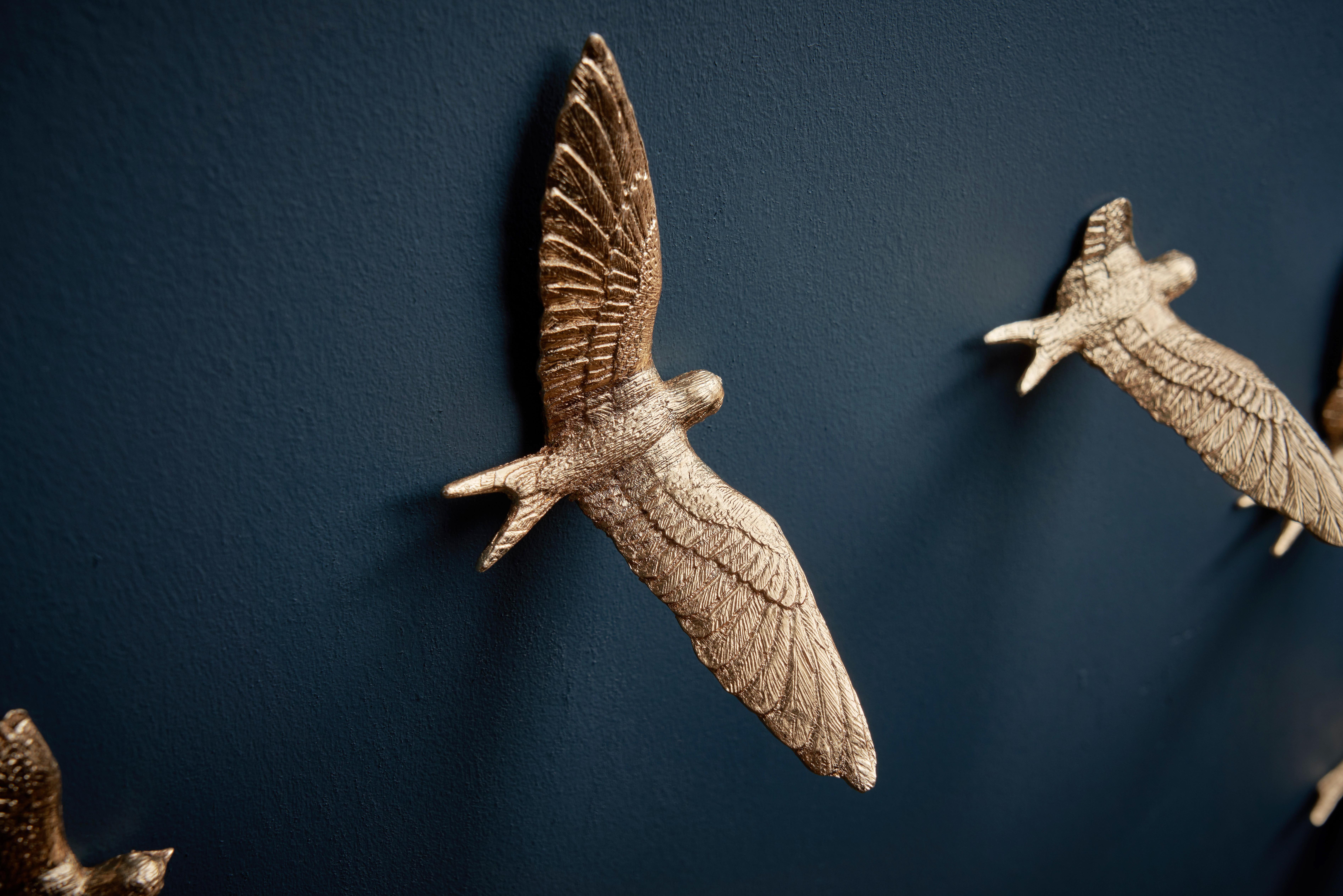 Wall clock bird close up
